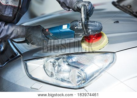 auto mechanic buffing car autobody bonnet