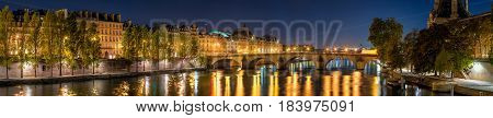 Panoramic view on the Seine River banks the Pont Royal bridge and Orsay Museum at dawn. Paris 7th Arrondissement France