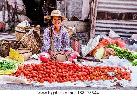 NYAUNGSHWE, MYANMAR- MARCH 5, 2017: People at local green market on March 5, 2017 in  Nyaungshwe  Village, Southeastasia, Myanmar. (Burma)