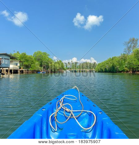 nose of canoe floating behind rower on a river