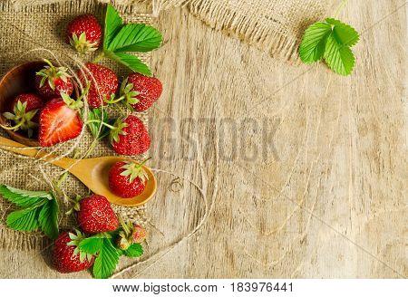 Ripe Tasty Strawberries Isolated On Burlap Background