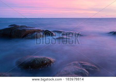 Long Exposure of Sunset at the sea Larn hin khao Rayong Thailand sunset at White rock beach Rayong
