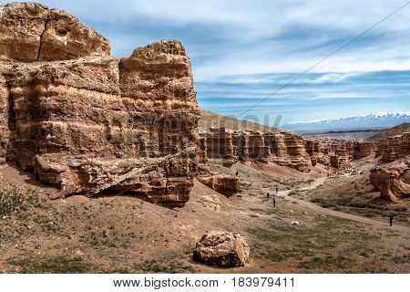 Charyn canyon, Almaty region, Kazakhstan - April 15, 2017. People descend to the bottom of the Charyn canyon. Charyn National Park - a unique object of nature, where the shape of the relief took shape of isolated rocks, columns and towers