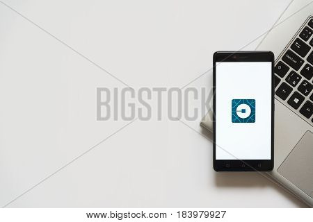 Bratislava, Slovakia, April 28, 2017: Uber new logo on smartphone screen placed on laptop keyboard. Empty place to write information.