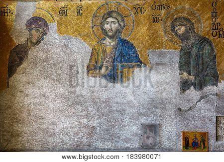 ISTANBUL TURKEY - JULY 9 2014: The Deesis mosaic in the interior of Hagia Sophia Istanbul Turkey. In this panel the Virgin Mary and John the Baptist are imploring the intercession of Christ Pantocrator for humanity on Judgment Day.
