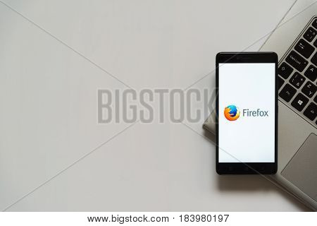 Bratislava, Slovakia, April 28, 2017: Mozilla firefox logo on smartphone screen placed on laptop keyboard. Empty place to write information.