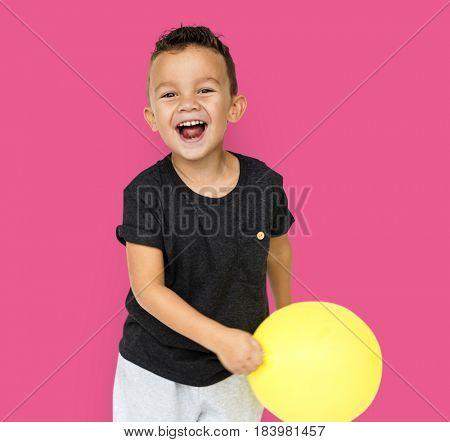 Little Boy with Yellow Balloon Studio Portrait