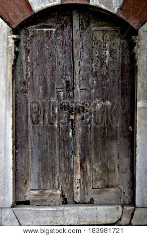 Old wooden door in a church decaying.
