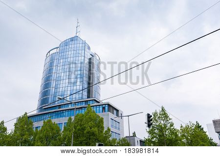 Glass Highrise Blue Facade Modern Office Building Business City Overcast Weather Trouble Clouds