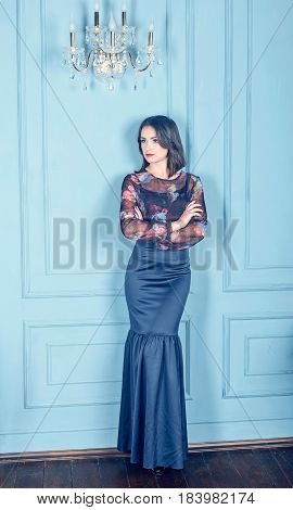 the beautiful young woman to the utmost in a classical interior a blue interior