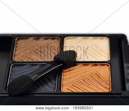 Cosmetic set of eyeshadow isolated on white background.