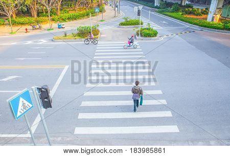 Men running on pedestrian zebra. Two guys in jeans crossing road on walk cross. Busy people, city life, safety walking