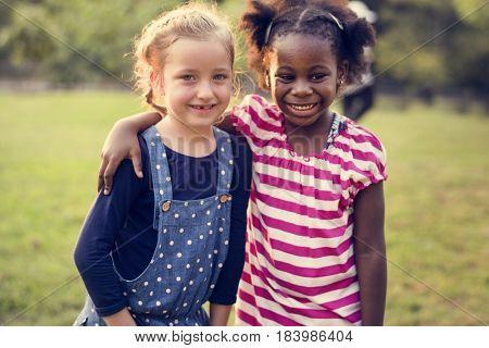 Little Girls Hugging Together Friendship