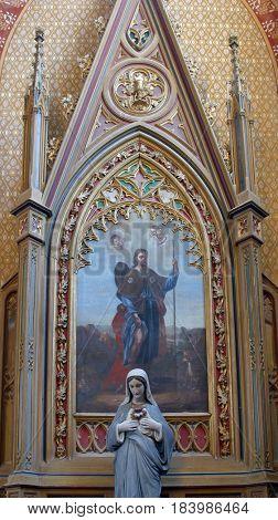 VELESEVEC, CROATIA - AUGUST 23: Saint Roch altar in the Parish Church of Saint Peter in Velesevec, Croatia on August 23, 2011.