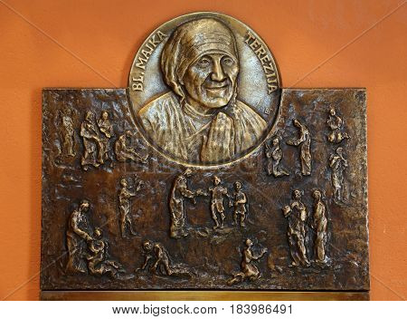 ZAGREB, CROATIA - MARCH 31: Bas relief with scenes from the life of Saint Mother Teresa of Calcutta, Chapel of Saint Dismas in Zagreb, Croatia on March 31, 2015
