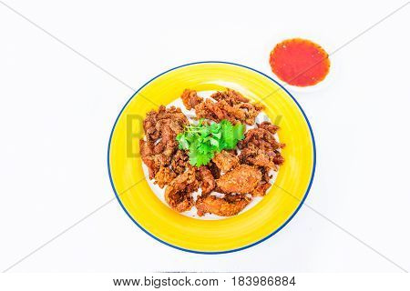 Fried chicken wings and crispy garlic in plate, Fried chicken Thai food style.