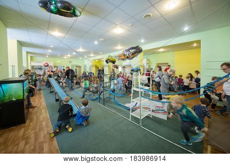 MOSCOW - FEB 18, 2017: Children with parents play in Muserage in Sokolniki