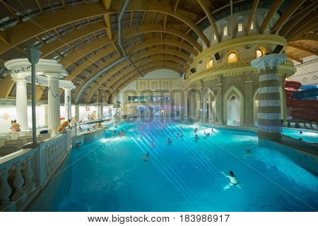 MOSCOW - FEB 18, 2017: People in waterpark Caribia. Caribia waterpark in Perovo was opened in 2012. Caribia - entertainment center with area of 22 thousand square meters