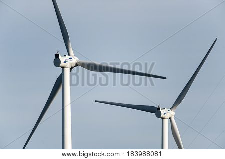 Fairhaven Massachusetts USA - August 22 2012: Pair of wind turbines paused in Fairhaven Massachusetts