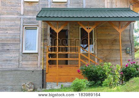 Wooden porch and veranda of modern cottage. Carpathians Ukraine