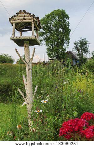 Original wooden birdhouse in summer Carpathians Ukraine