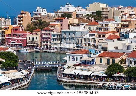 AGHIOS NIKOLAOS, CRETE, GREECE - APRIL 2017: Architecture of a small harbor at Aghios Nikolaos town on Crete island, Greece