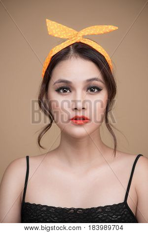 Portrait Of Asian Girl With Pretty Smile In Pinup Style On Yellow Background