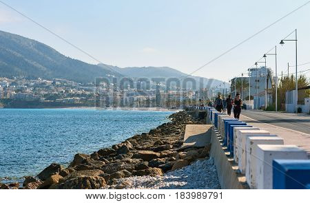 Altea Spain - April 8 2017: People walking along the seafront in the resort town of Altea the most beautiful place in the Costa Blanca. Spain