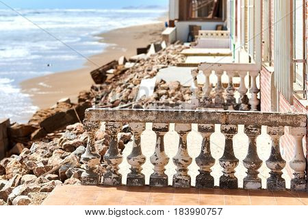 Guardamar del Segura, Spain - April 21, 2017: Damaged beach houses. The wind and waves is washed away the beach houses on the Babilonia beach. Guardamar del Segura. Province of Alicante. Spain