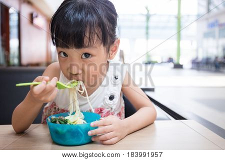 Asian Little Chinese Girl Eating Beef Noodles