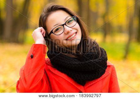 autumn portrait Korean girl smiling in glasses