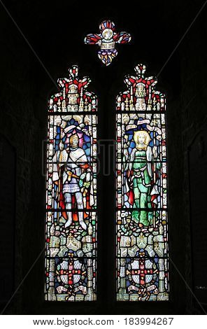 Cornwall, Uk - April 3 2017: Beautiful Intricate Stained Glass Window In A Stone Built Church
