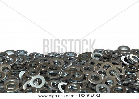 Metal washers in a pile close up with an isolated white background and copy space