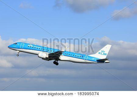 Amsterdam the Netherlands - April 7th 2017: PH-EZG KLM Cityhopper Embraer ERJ-190STD takeoff from Polderbaan runway Amsterdam Airport Schiphol
