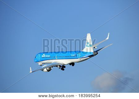Amsterdam the Netherlands - April 7th 2017: PH-EZA KLM Cityhopper Embraer ERJ-190STD takeoff from Polderbaan runway Amsterdam Airport Schiphol