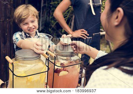 Little Boy Selling Lemonade at Fresh Market