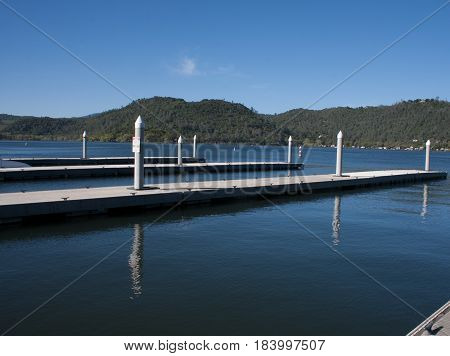 Boat dock on Clearlake right after fishing boats have come in and before the rush of ski boats launch for a day of play
