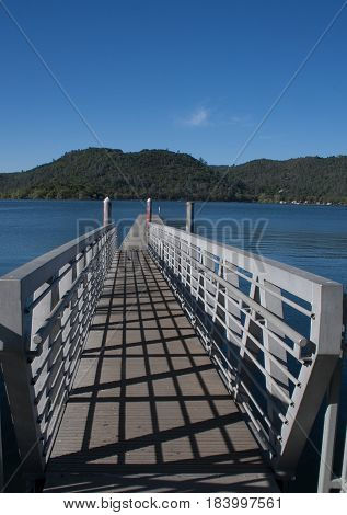 Take a long walk on a long pier leading to beautiful Clearlake with mountains in the distance