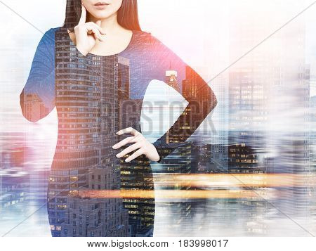 Close up of an unrecognizable black haired businesswoman in a dress standing against a night city panorama. Mock up toned image double exposure