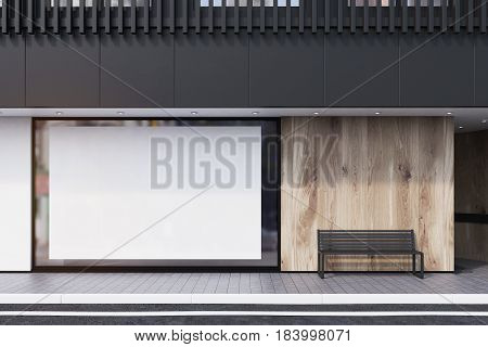 Shop window with a large horizontal poster a bench and a black balcony on the second floor. Concept of promotion. 3d rendering mock up