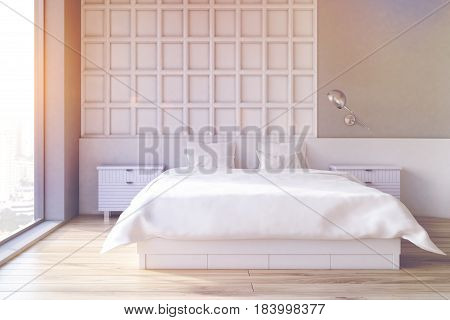 Interior of a bedroom with gray and white wooden wall element a double bed and two bedside tables. 3d rendering toned image