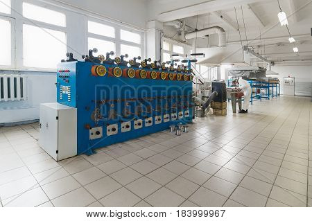 Tinning shop of copper-aluminum wire. Automatic machines for winding wire on bobbins.