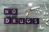 Design for International Day against Drug Abuse. The concept of No drugs or anti doping in sport or zero tolerance to drugs. No drugs concept drugs pills on a wooden background top view flat lay. poster