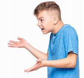 Profile of shouting boy - emotional portrait of irritated caucasian teen boy. Furious teenager screaming and looking with anger to side. Handsome outraged child shouting out loud, on white background. poster