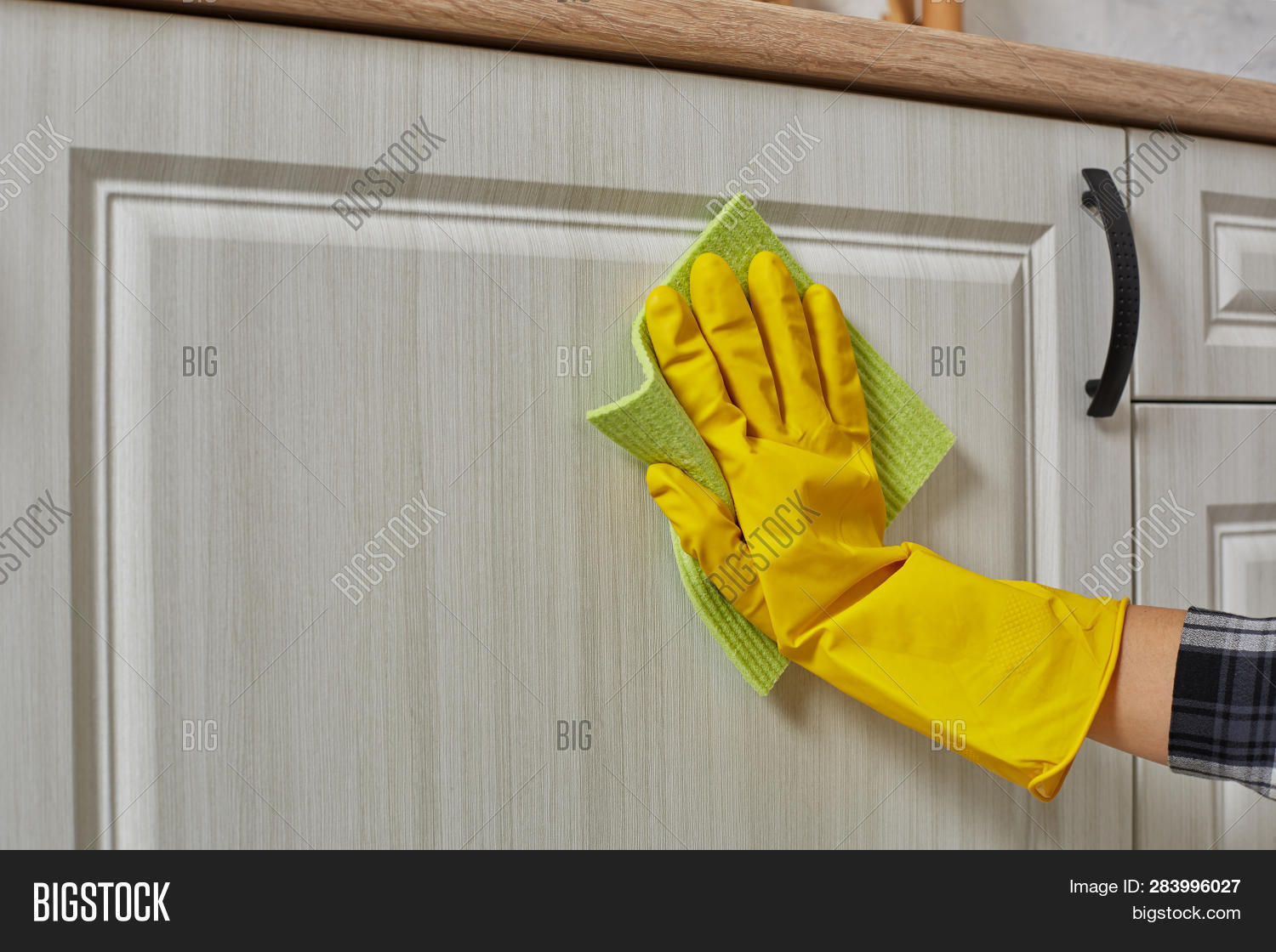2283c0e330908 Hands In Gloves With Green Rag Is Cleaning Kitchen Cabinets - Housework And Housekeeping  Concept