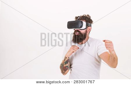 Man With Beard In Vr Glasses Fighting, White Background. Vr Gadget Concept. Hipster On Busy Face Exp