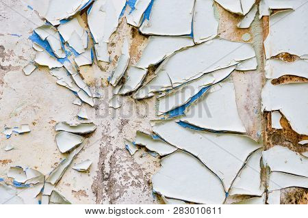 White Cracked Painting On Old Plaster Wall Surface
