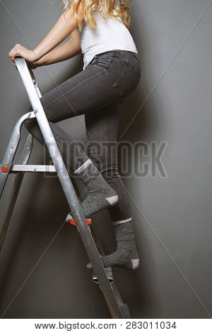 Unrecognizable Woman Climbing Ladder In Socks - Home Improvement Diy Or Household Accident Risk Conc