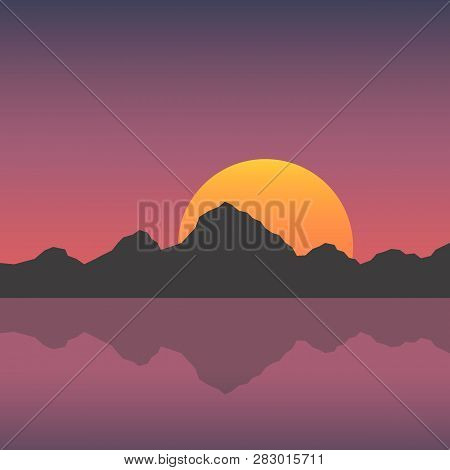 Sunset In The Mountains With A Lake