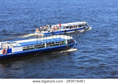 Cruise Excursion Boats Isolated On River Water In Saint Petersburg, Russia. Two Small Cruise Tourist